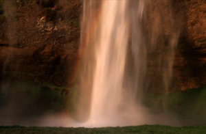 Seljalandsfoss waterfall at sunset