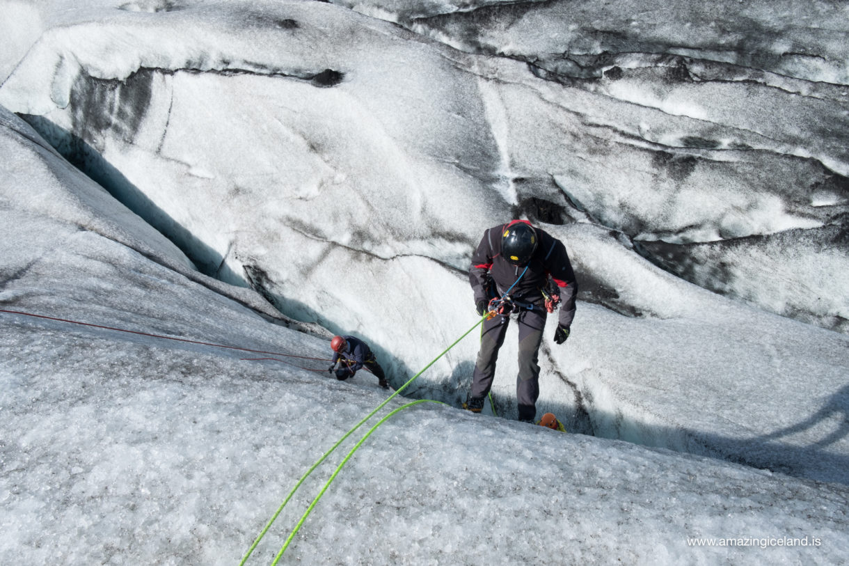 Ice climbing on Solheimajokull glacier on south coast of Iceland