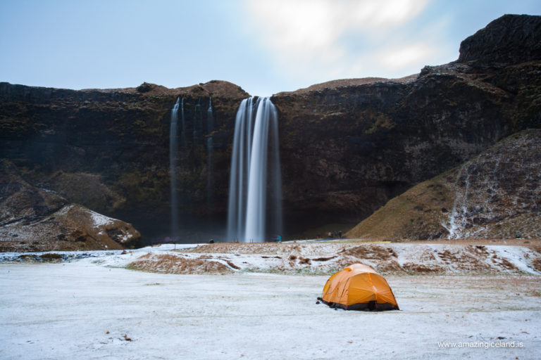 Winter tent camping by Seljalandsfoss waterfall