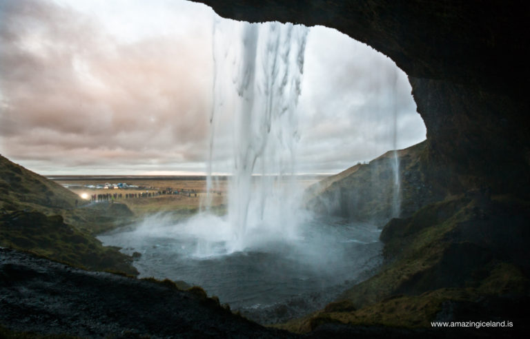 Behind Seljalandsfoss waterfall on south coast of Iceland