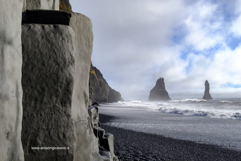 Reynisdrangar rock formation at black sand beach in Iceland