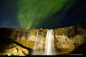Aurora borealis over Seljalandsfoss waterfall on the south coast of Iceland