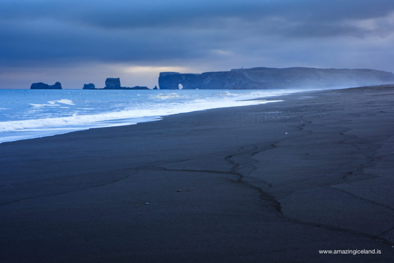 Black sand beach and Dyrholaey in South coast of Iceland