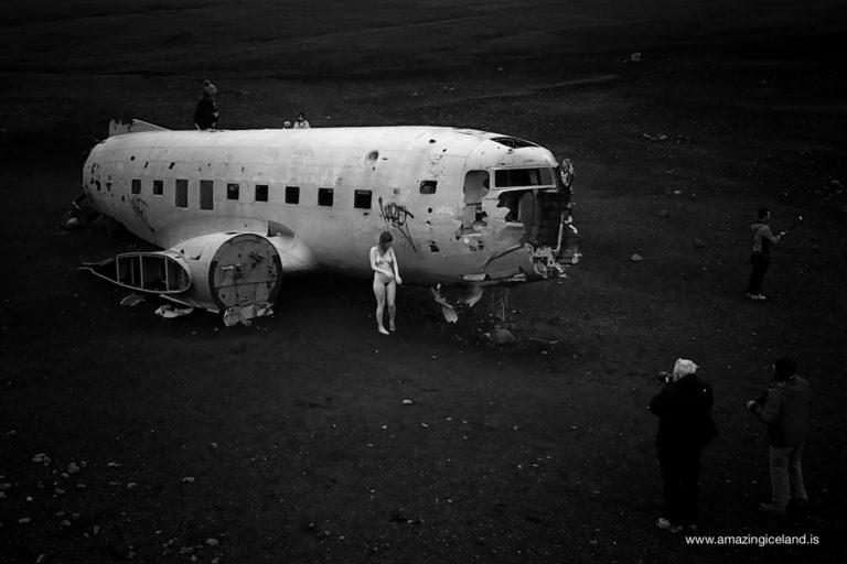 Nude photography by Douglas C-117 Plane wreck on Sólheimasandur on south coast of Iceland