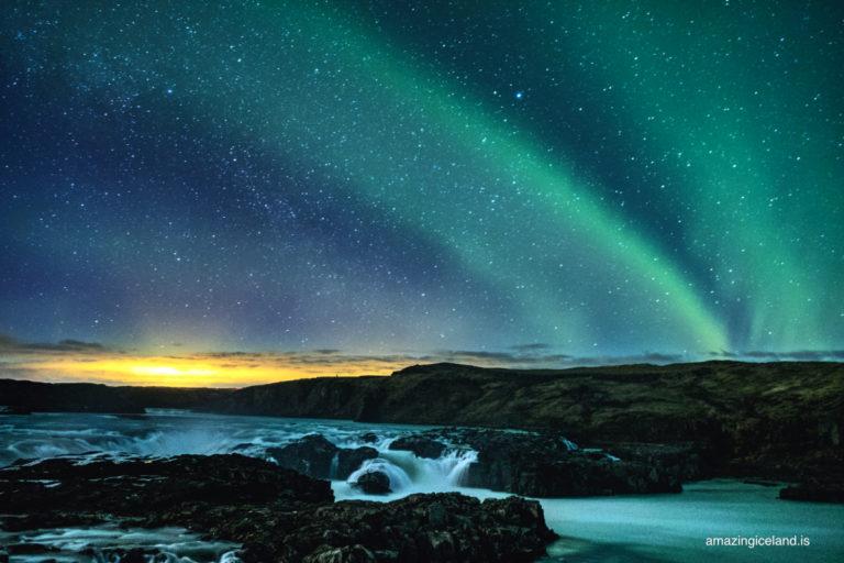 northern lights over Urriðafoss waterfall