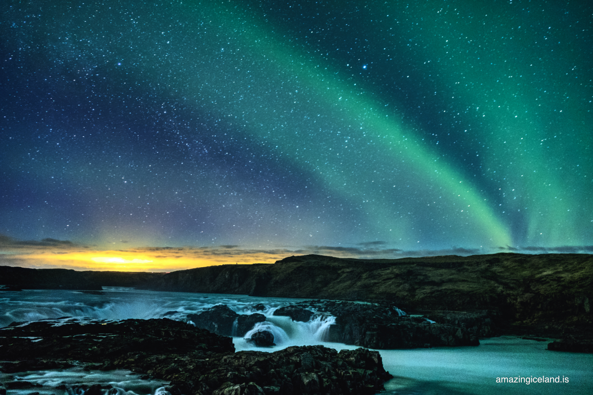 northern lights over Urriðafoss waterfall