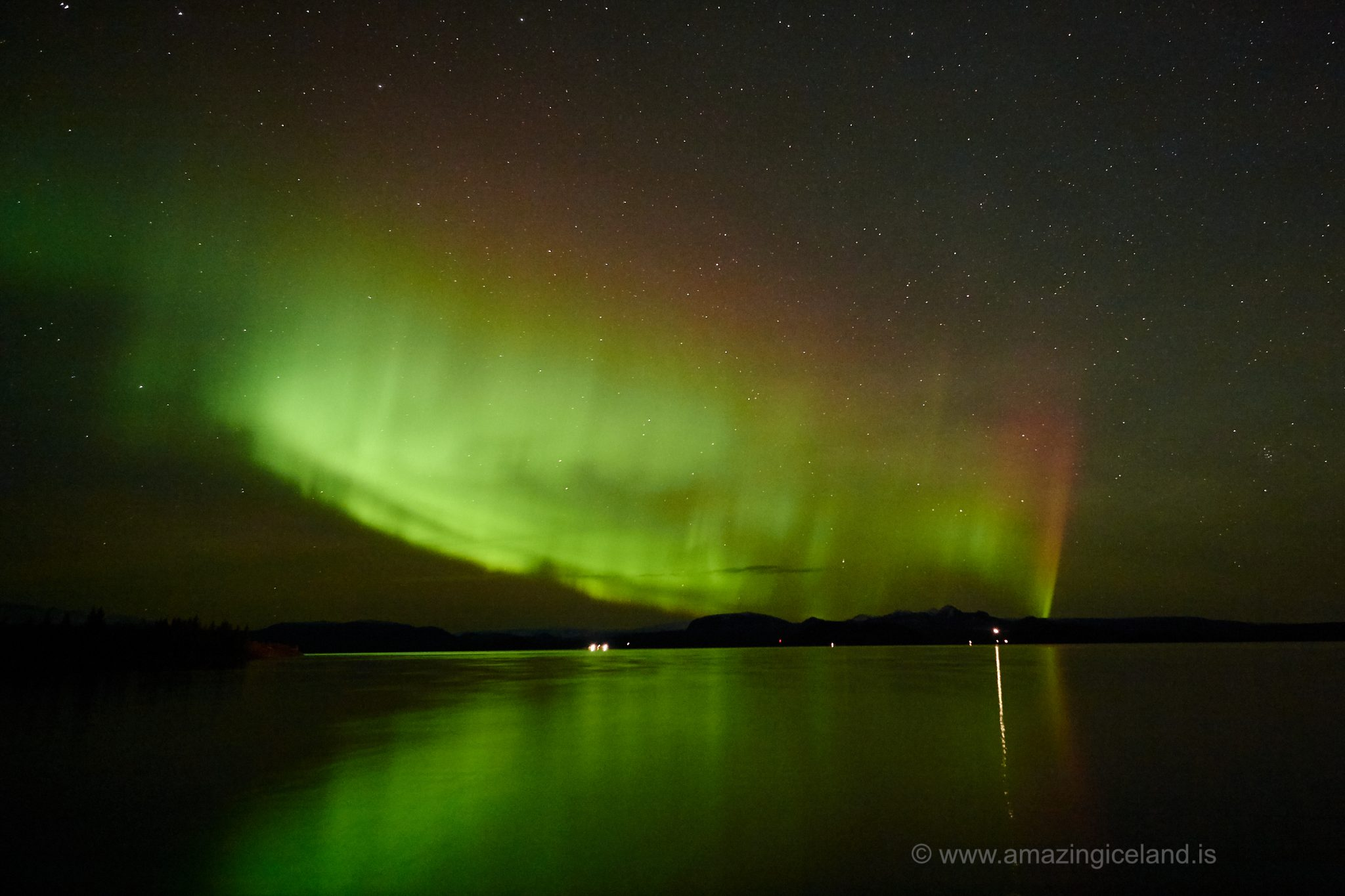 Aurora borealis over lake Thingvellir in Thingvellir national park Iceland