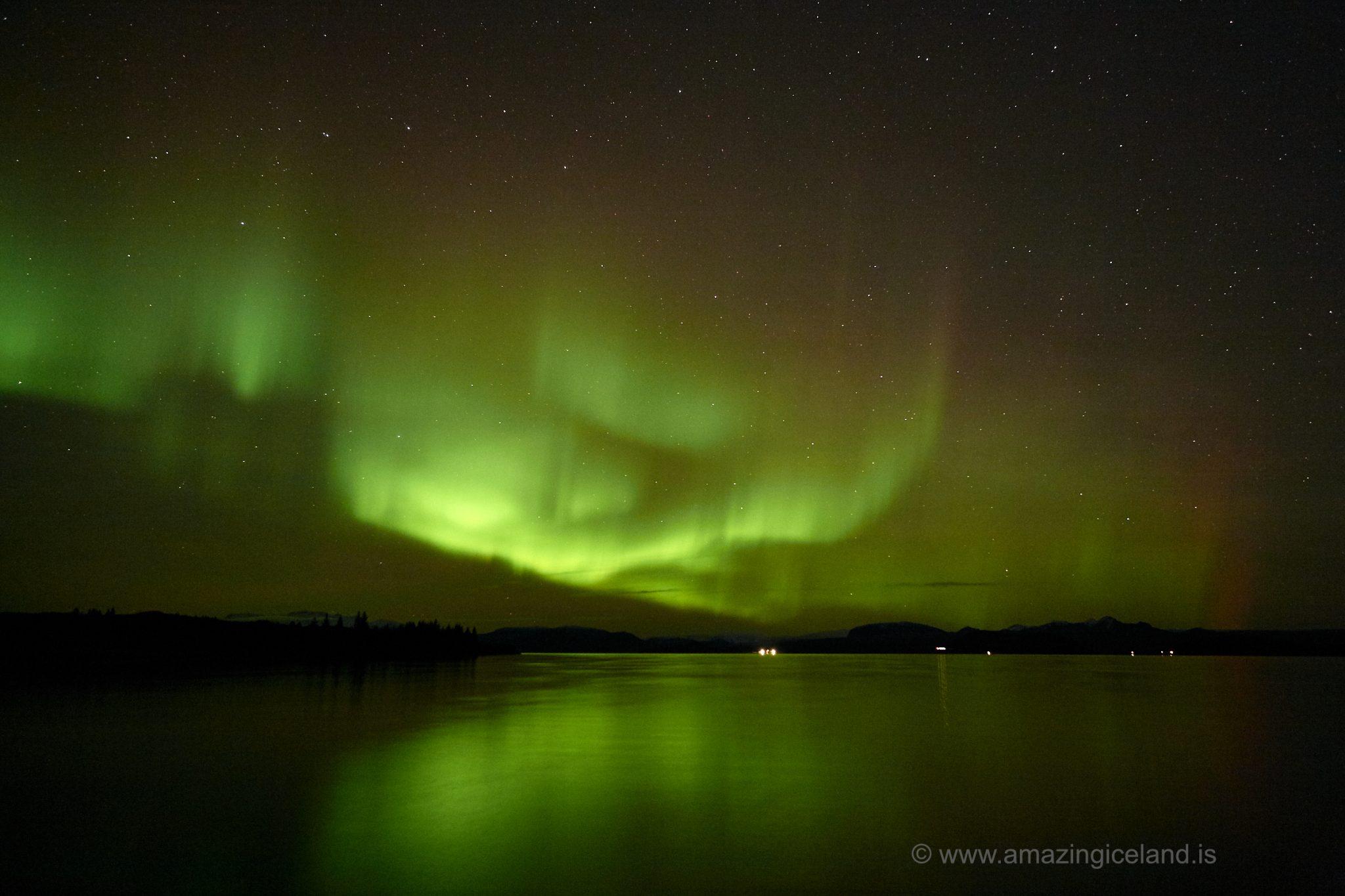 Northern lights over lake Thingvellir national park in Iceland