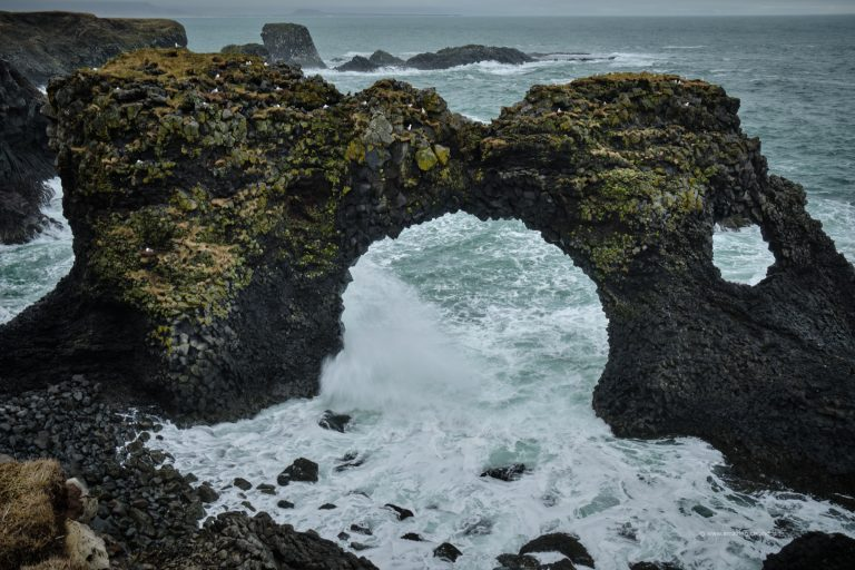 Hole in the cliff at Arnarstapi in Snæfellsnes Iceland