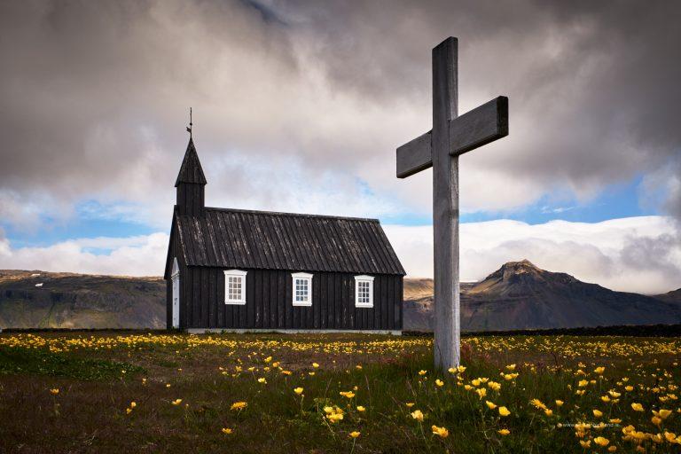 Cross in front black church at Budir