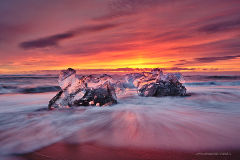 Ice diamond by glowing sunrise at Diamond beach in Iceland