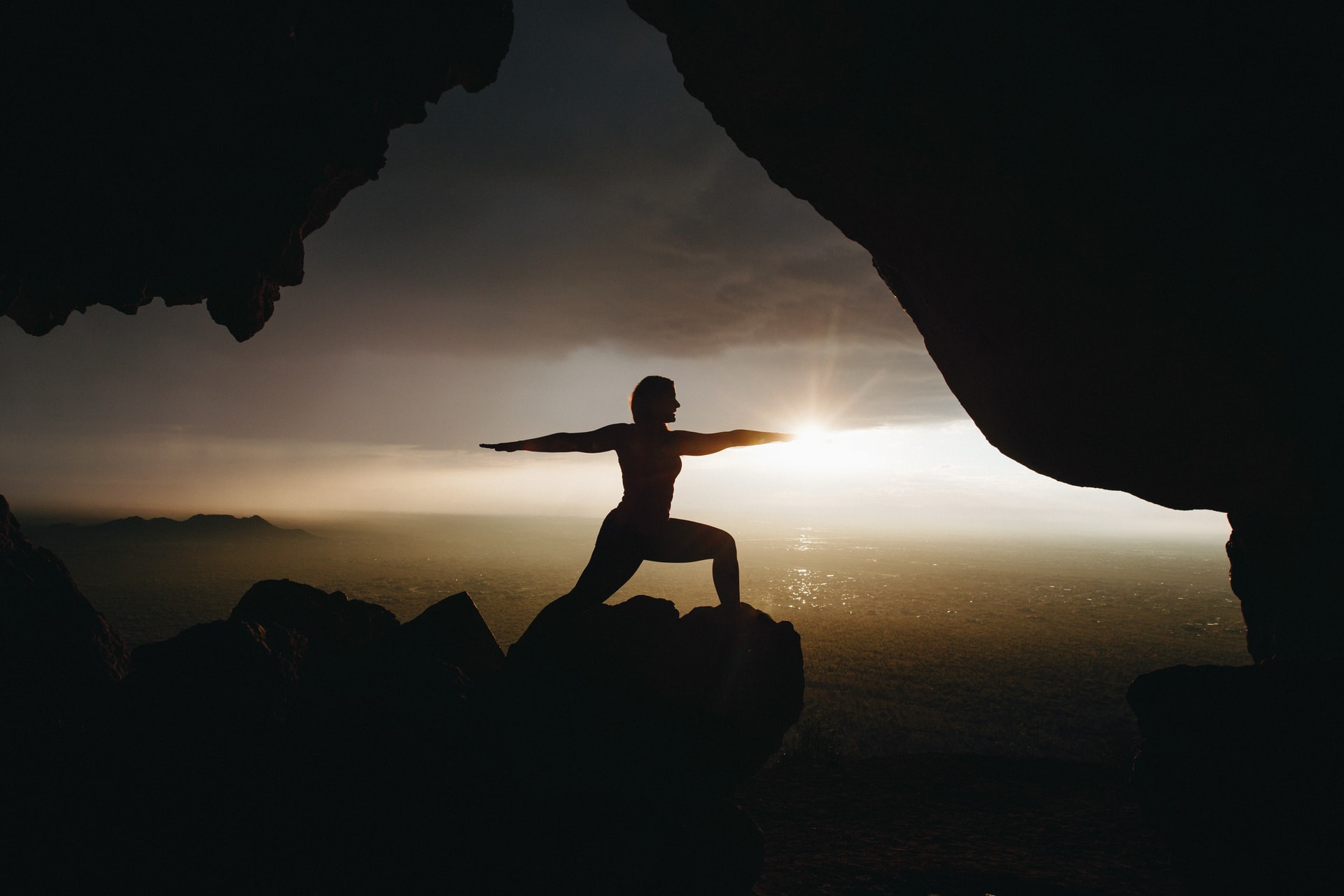 Yoga on mountain top at sunset